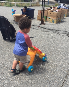 Marshall plays with lion at community cookout